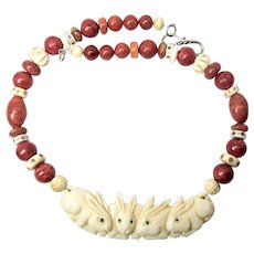Carved Bone Rabbits, Apple Coral Necklace