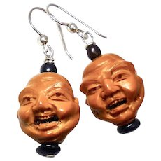 Hand Carved Olive Pit Faces Drop Earrings