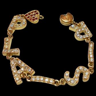 "Signed Yves Saint Laurent Gold Tone ""PLAISIR"" Rhinestone Bracelet c. 1980"