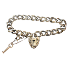 Signed Sterling Victorian Repousse Heart Lock Bracelet with Key circa 1900