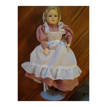 Blonde 1984 Enesco Porcelain Doll Depicting 1800's dress