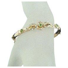 Edwardian 9 Carat Gold Peridot Seed Pearl Hinged Bangle Bracelet