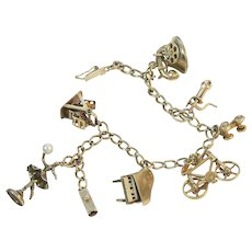 14K Gold Charm Bracelet with Many Mechanical Charms