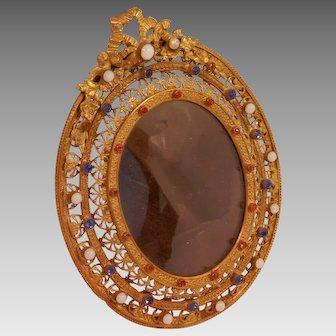 Gilt Filigree jeweled Frame on Brass...