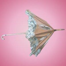 Antique parasol doll
