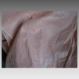 I sell fine pink cotton with blue stripes