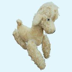 Antique blonde plush dog