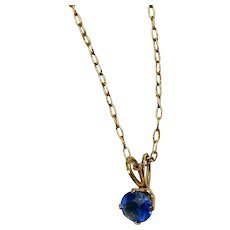 Bright Blue Stone Pendant on Gold Tone Chain