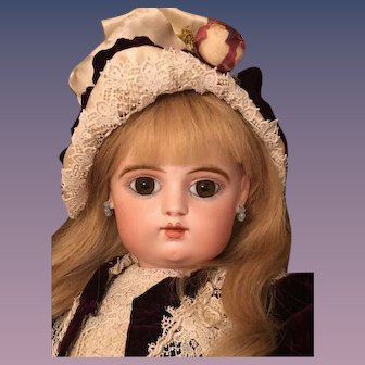"""LayAway for 'T'_ 26""""  French Gaultier Bebe, closed mouth, molded tongue, scroll and marked FG 9."""
