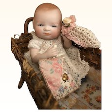 "Thank you 'S'_5"" All Bisque Glass-eyed Bye-Lo Baby in Primitive Wicker Bed_Swivel head w/Blue Shoes_Grace S. Putnam_c. 1925 Germany."