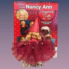 HOLD for 'D'_Rare Rose Red Judy Ann USA Early all Bisque Nancy Ann Story Book Doll with Magenta outfit and Dunce Cap and chair