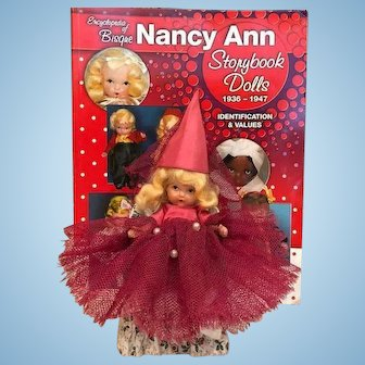 Rare Rose Red Judy Ann USA Early all Bisque Nancy Ann Story Book Doll with Magenta Dunce Cap and chair