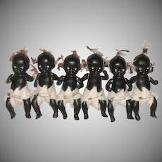 All Bisque Black Baby Dolls_set of six_'Old Store Stock' w/stickers_braided pigtails and a top knot