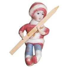 German Christmas Heubach Boy Child Holding a Wooden Ski