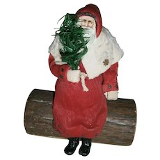 Vintage German Crepe Paper Cotton Santa Sitting on Log Candy Container