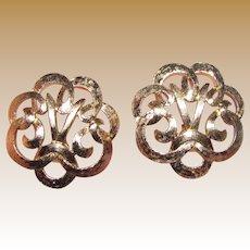 Sophisticated Goldtone Swirl Clip Earrings by Monet
