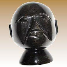 Eerie Iridescent Carved Black Stone Head Sculpture