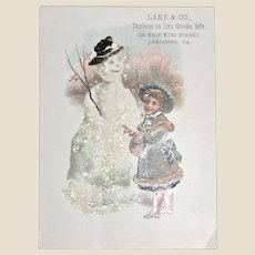 Victorian Trade Card, Lane & Co. Dealers in Dry Goods, Lancaster PA, Pretty Girl Snowman Winter 1889