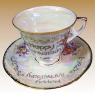 Delightful Vintage Pink Luster Anniversary Cup and Saucer by Lugene's