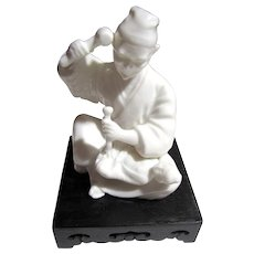 Signed Japanese Blanc de Chine Figurine of Sculptor Carving a Buddha