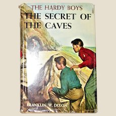 Hardy Boys #7: The Secret of the Caves by Franklin W. Dixon 1960B 50th Printing, VG