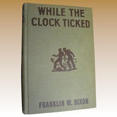 """Hardy Boys, """"While The Clock Ticked"""" by Franklin Dixon, Grosset & Dunlap 1932 Orange Endpapers"""