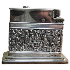 Vintage Mylflam 830 Silver Table Lighter with Embossed Relief of Tavern Scene with Musicians, Circa 1920's