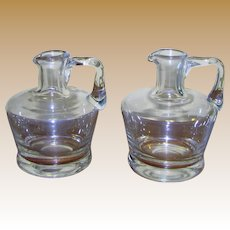 Pair of Early American Hand Blown Clear Glass Small Syrup Pitchers, Handle Ground Pontil  Bottle
