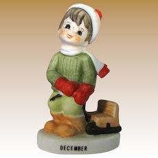Lefton December Christmas Figurine of Boy Pulling Sled