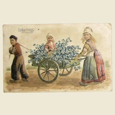 """1909, """"Greetings"""" Embossed Post Card, Picture of Dutch Children in a Cart, Printed in Germany"""