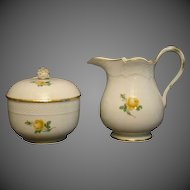 Meissen porcelain yellow rose creamer and covered sugar crossed swords