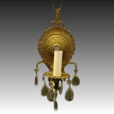 Brass and crystal Spanish single light wall sconce