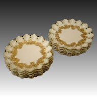 Limoges T&V set of twelve floral reticulated openwork plates