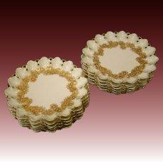 Limoges T&V set of twelve floral reticulated openwork plates