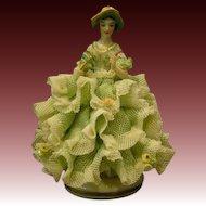 Dresden lacy  figurine woman holding fan