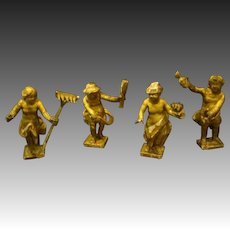 Antique set of four wood carved gesso small figures