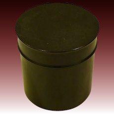 Ebony wood cylindrical covered dresser box marked
