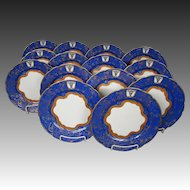Blue gilded ornate hand painted set fourteen luncheon plates bull's head crown mark