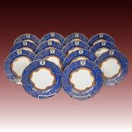 Ornate gilded blue set fourteen salad plates bull's head crown mark scalloped edge