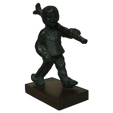 Bronze sculpture of young boy with skis skier