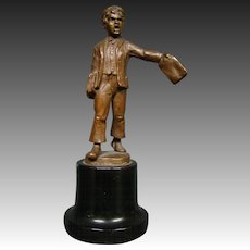 Antique bronze sculpture of newspaper paper boy
