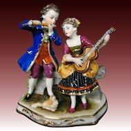 Dresden Germany figurine man woman courting scene pekingese dog Muller & Co