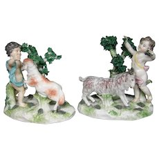 Antique Chelsea porcelain pair of cupid goat figurines gold anchor mark