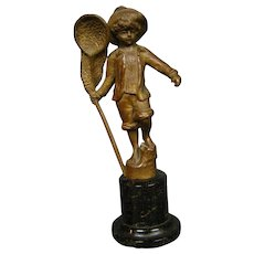 Antique bronze sculpture of boy with butterfly net marble base