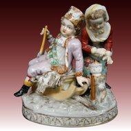 Dresden Germany porcelain figurine boy on sled girl at fire