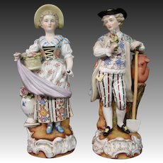 Beehive mark pair of porcelain figurines man and woman