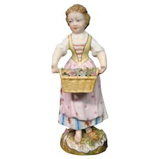 German porcelain figurine girl with basket of flowers marked