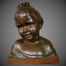 Well detailed bronze bust sculpture child with curly hair dated 1922