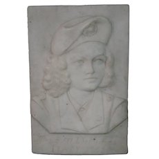 Italian carved marble plaque sculpture of woman dated 1945