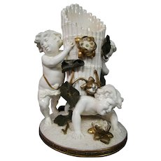 Longwy large figural cupid or putti vase carrying basket